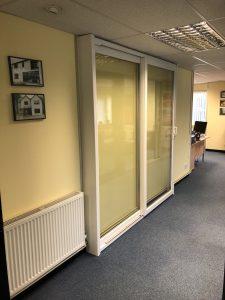White sliding door in showroom