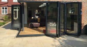 black aluminium bifold door open