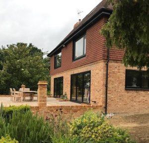 Black uPVC flush windows and air bifold doors Surrey Sussex