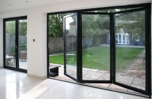 white home with bifold doors partially open