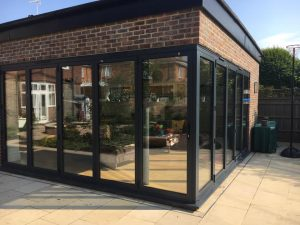 corner of home with closed bifold doors