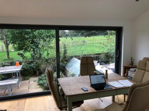 Office table with bifold doors in background