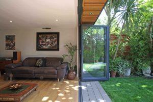 Garden room showing bifold doors open